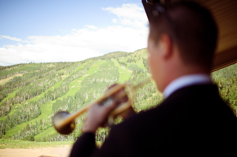 Groom playing trumpet before Steamboat wedding