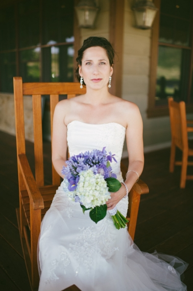 Bride sitting in rocking chair