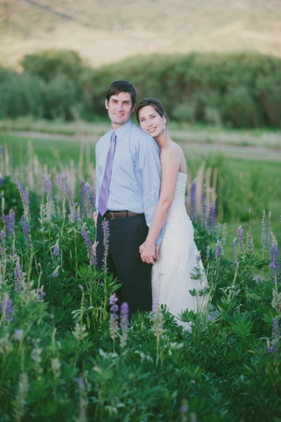 Bride and groom in field of lupine; Colorado wedding