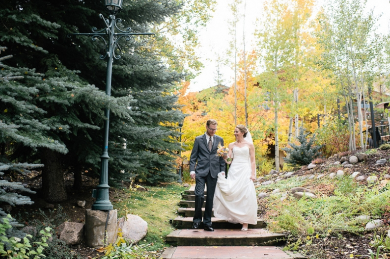 Bride and groom walking through Vail