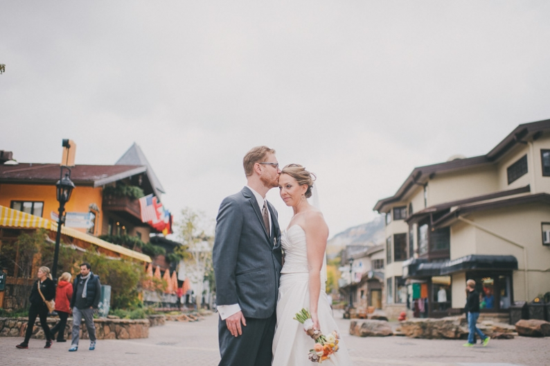 bride and groom with colorful signs in Vail